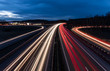 canvas print picture - white and red car light trails on motorway junction