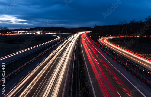 Poster Autoroute nuit white and red car light trails on motorway junction