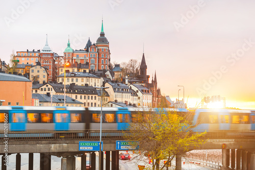 Photo  Stockholm, view of buildings and train at dusk