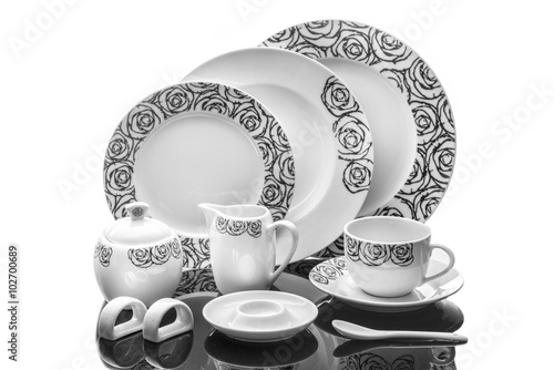 Fotografie, Obraz  dining porcelain set of plates, cup and napkin ring with ornament isolated on wh