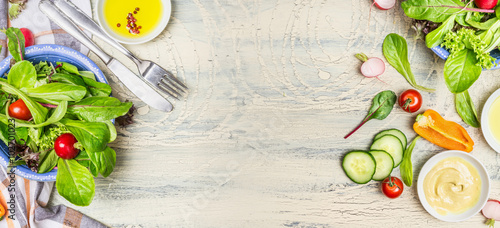 Fotografie, Obraz  Various green organic salad ingredients on  light rustic background, top view, banner