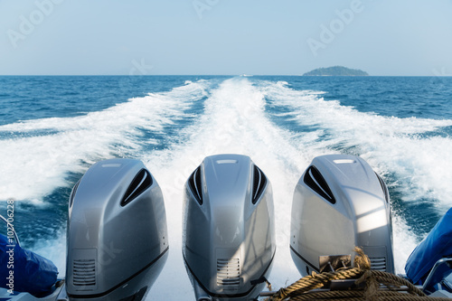 Three powerful engines mounted on the speedboat
