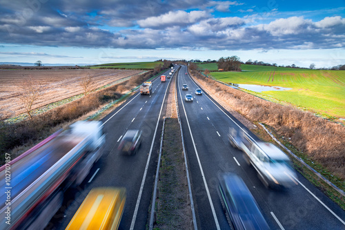 Fotografie, Obraz  Fast moving Vehicles on Busy Motorway at the Morning