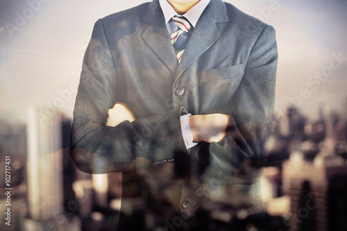 Valokuva  Double exposure of business man body in suit and blurred city