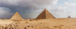 Giza pyramid complex on the background of clouds and Cairo panorama