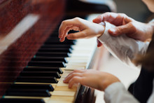 Experienced Master Piano Hand Helps The Student