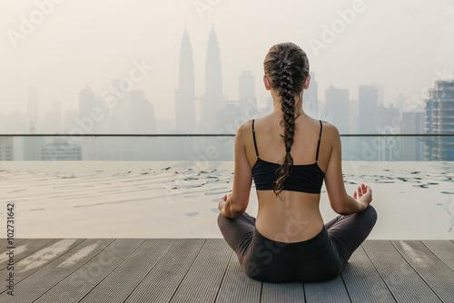 Fotografia, Obraz  Relaxed young yoga woman in yoga pose near pool.