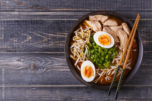 Japanese ramen soup with chicken, egg, chives and sprout.