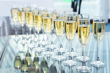 Elegant Glasses With Champagne Standing In A Row On Table