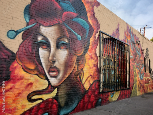 Graffiti Vividly painted industrial warehouse wall exterior - landscape color photo