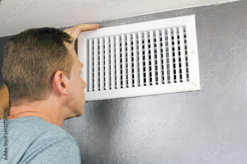 Fotografia, Obraz  Inspecting a Home Air Vent for Maintenance