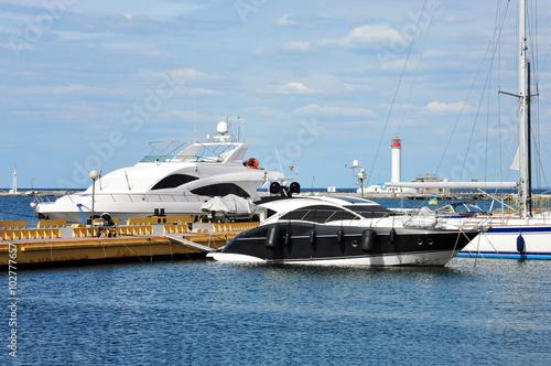 Poster Nautique motorise Motor yacht over harbor pier, Odessa, Ukraine