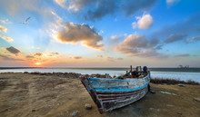 Old Wooden Fishing Boat At Sunset