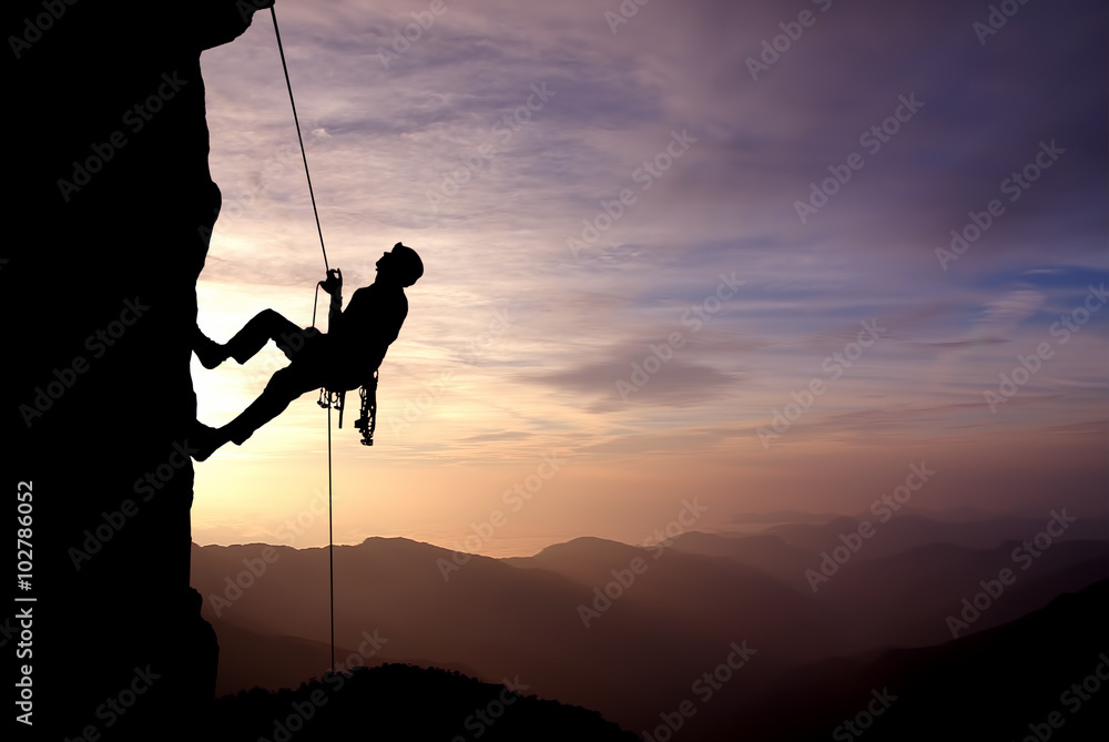 Fototapety, obrazy: Silhouette of Rock Climber at Sunset