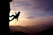 Silhouette Of Rock Climber At ...