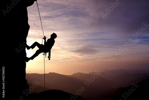 Fotografie, Obraz  Silhouette of Rock Climber at Sunset