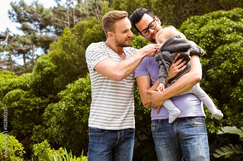 Smiling gay couple with child Canvas Print