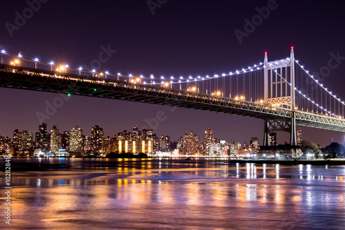 Beautiful night view of New York City and the 59th Street Ed Koch Bridge looking across to Manhattan. - 102828416