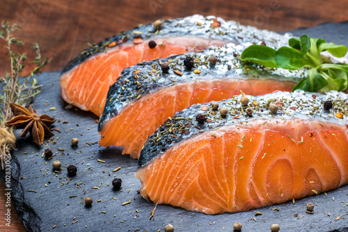 Foto op Aluminium Vis Fresh salmon portions with herb and pepper seasoning.