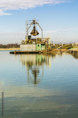 Fotografia, Obraz  Digger dredging in the gravel pit water.