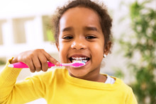 Little Beautiful African Girl Brushing Teeth