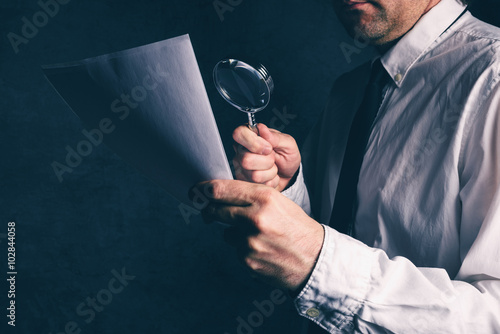 Fotomural  Tax inspector doing financial auditing, businessman reading business report or c