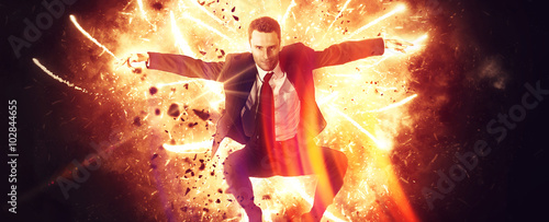 Fotografie, Obraz  Wide view of leaping businessman in explosion