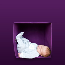 Baby In Lila Box