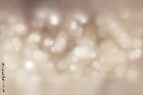 Poster Bokeh light, shimmering blur spot lights on beige abstract