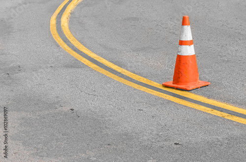 Fotografie, Obraz  Orange traffic cone on double yellow lines