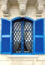 Window With Blue Shutters Open In Malta