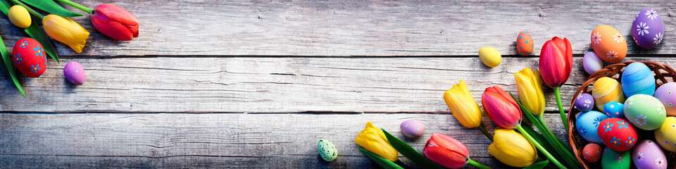 Tulips And Painted Eggs On Vintage Wooden Plank - Easter Background