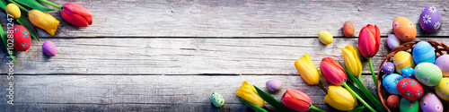 Foto op Plexiglas Tulp Tulips And Painted Eggs On Vintage Wooden Plank - Easter Background