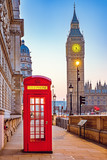 Fototapeta Londyn - Traditional red phone booth and Big Ben in London
