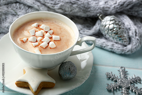 Spoed Foto op Canvas Chocolade Cup of hot cacao with marshmallow, cookies and warm scarf on blue table