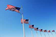 USA Flags In A Row Waving In The Wind