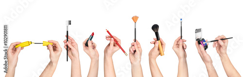 Fotografía  collection of hands holding tools for makeup isolated on white b