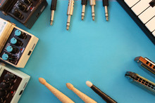 Music Concept Border Design - Guitar Pedal, Harmonica, Piano Key, Audio Card, Audio Plug And Drum Stick - Copy Space