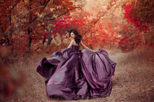 Lady In Luxury Lush Purple Dress Runs In Red Wood ,fantastic Shot, Fairytale Girl Princess Walking In Autumn Forest, Fashionable Toning, Creative Colors. Woman Fantasy Queen, Skirt Fabric Fly In Wind