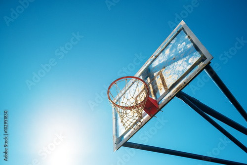 Plexiglass street basketball board with hoop on outdoor court Canvas Print