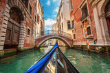 Fototapeta  - View from gondola during the ride through the canals of Venice i