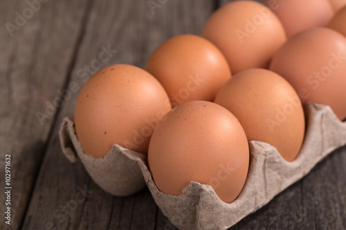 Brown Eggs in an Egg Carton on a Wooden Surface