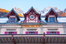 Facade Of Chamonix Train Station Near Mont Blanc, France, Frenck Alps And Mountain Peaks Lightened With Sun On The Background