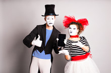 Two Mimes Use Of Tablet And Thumb Up,  April Fools Day Concept