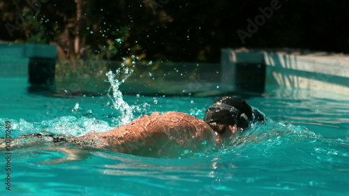 Fit man swimming in the pool Canvas Print