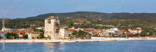 Fotografie, Obraz  Ouranoupolis town and houses view, harbor,  ancient Tower of Ouranoupolis , Athos, Greece