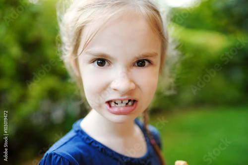 Adorable little girl making funny faces on beautiful summer day Canvas-taulu