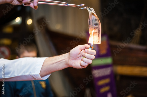 Fotografie, Obraz  Chemistry experiment with bill on fire