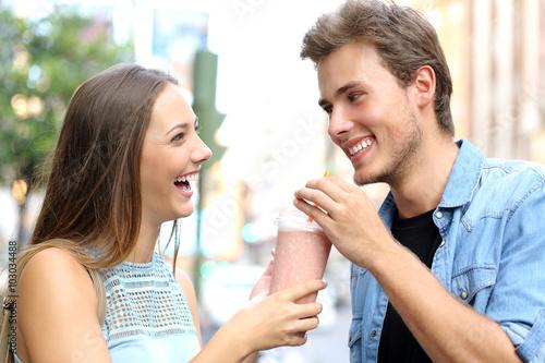 Foto op Plexiglas Milkshake Couple or friends sharing a milkshake