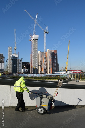 Photo Urban scene from Wembley, London with street sweeper and new develoment in backg